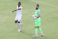 CARY, NC - AUGUST 01: Matt Vanoekel #1 and Boluwatife Akinyode #3 look for an open teammate during a game between Birmingham Legion FC and North Carolina FC at Sahlen's Stadium at WakeMed Soccer Park on August 01, 2020 in Cary, North Carolina.