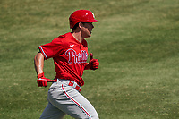 Philadelphia Phillies Nick Maton (67) runs to first base during a Major League Spring Training game against the Baltimore Orioles on March 12, 2021 at the Ed Smith Stadium in Sarasota, Florida.  (Mike Janes/Four Seam Images)