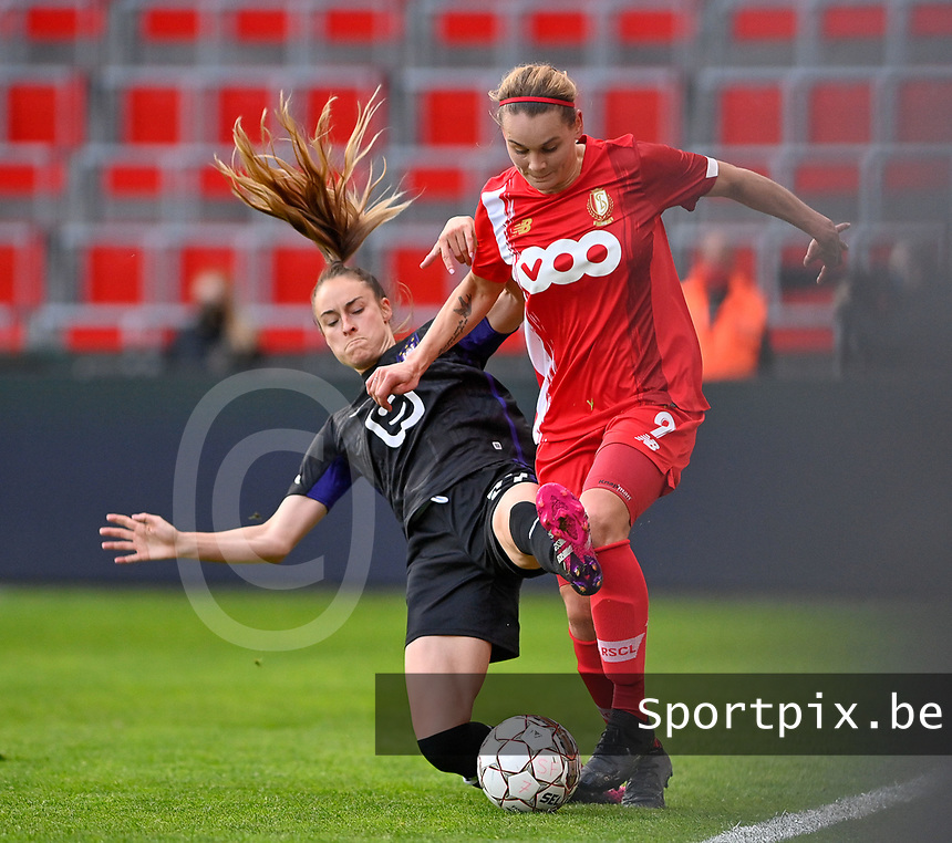Tessa Wullaert (27) of Anderlecht pictured tackling Sylke Calleeuw (9) of Standard  during a female soccer game between Standard Femina de Liege and RSC Anderlecht on the 8th matchday in play off 1 of the 2020 - 2021 season of Belgian Scooore Womens Super League , tuesday 18 th of May 2021  in Angleur , Belgium . PHOTO SPORTPIX.BE | SPP | DAVID CATRY