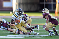 Arkansas Pine-Bluff's quarterback Benjamin Anderson (11) is tackled by Texas State defenders during NCAA Football game, Saturday, August 30, 2014 in San Marcos, Tex. Texas State leads Arkansas Pine-Bluff 42-0 at the halftime. (Mo Khursheed/TFV Media via AP Images)