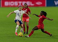 ORLANDO CITY, FL - FEBRUARY 18: Megan Rapinoe #15 begins to turn away from the pressure by Deanna Rose #6 during a game between Canada and USWNT at Exploria stadium on February 18, 2021 in Orlando City, Florida.