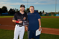 Batavia Muckdogs J.D. Orr (22) poses for a photo with Booster Club President Hal Mitchell after being awarded the teams Most Popular Player Award before a NY-Penn League game against the Auburn Doubledays on August 31, 2019 at Dwyer Stadium in Batavia, New York.  Auburn defeated Batavia 12-5.  (Mike Janes/Four Seam Images)