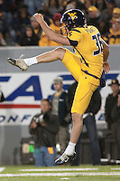 WVU punter Gregg Pugnetti. The West Virginia Mountaineers defeated the South Florida Bulls 20-6 on October 14, 2010 at Mountaineer Field, Morgantown, West Virginia.
