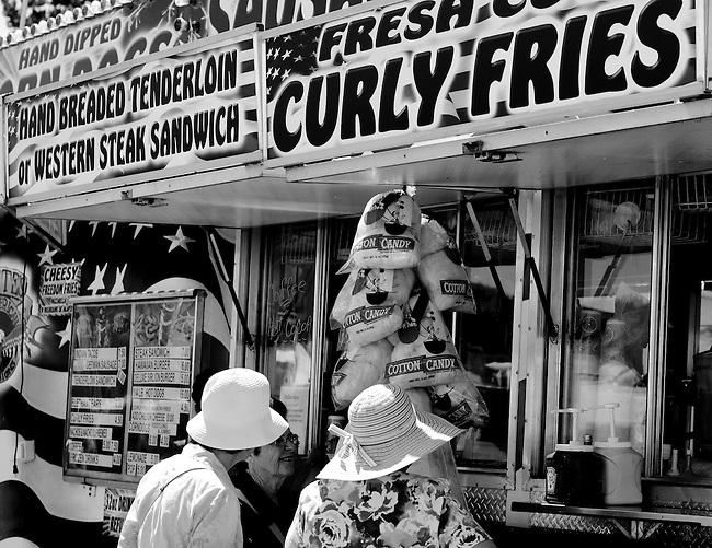Three women buying treats at the Pow Wow.