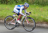 Evelyn Yesenia Garcia Marroquin (El Salvador, #51).  Olympics 2012.  Women's cycle road race passes along the Shere bypass, the A25, on it's way to Box Hill and then back to the finish in London.