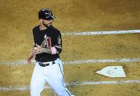 May 13, 2012; Phoenix, AZ, USA; Arizona Diamondbacks second baseman Ryan Roberts after scoring in the second inning against the San Francisco Giants at Chase Field. Mandatory Credit: Mark J. Rebilas-
