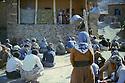 Iran 1983 .In the village of Bejveh, district of Sardasht, the Fedayin Khalk party announcing to the villagers the imminent arrival of the Iranian army.Iran 1983.Dans le village de Bejveh, region de Sardasht, rassemblement de la population par les Fedayin du Peuple  pour annoncer l'arrivee imminente de l'armee iranienne