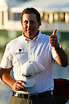 DORAL, FL. - Phil Mickelson gives a thumbs to a fan in the gallery after winning the 2009 World Golf Championships CA Championship at Doral Golf Resort and Spa in Doral, FL. on March 15, 2009
