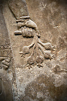 Assyrian relief sculpture panel of a protective spirit holdingpomegrantes from Nimrud, Iraq.  865-860 B.C North West Palace, Room Z.  ref: British Museum Assyrian  Archaeological exhibit WA 118874