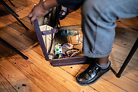 Equipment for magic tricks inside a student's briefcase at the Cape Town College of Magic.