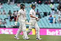 7th January 2021; Sydney Cricket Ground, Sydney, New South Wales, Australia; International Test Cricket, Third Test Day One, Australia versus India; Will Pucovski  and Marnus Labuschagne of Australia leave the field at the break