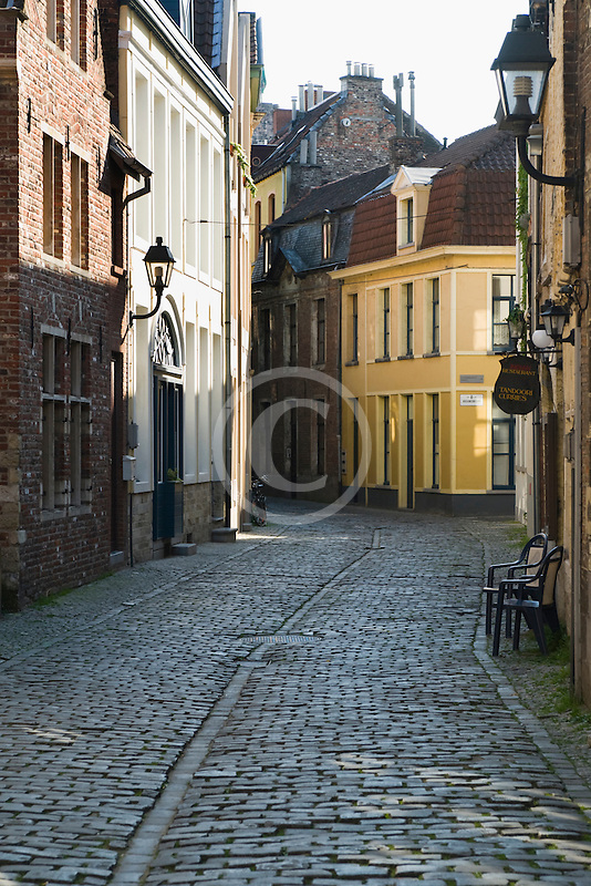 Belgium, Bruges, Narrow cobbled street with houses
