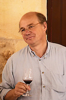 Jean-Francois Quenin, owner and wine maker, in the tasting room holding a glass of his wine  Chateau de Pressac St Etienne de Lisse  Saint Emilion  Bordeaux Gironde Aquitaine France