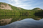 Reflection of White Horse Ledge and Cathedral Ledge in Echo Lake from Echo Lake State Park in North Conway,  New Hampshire USA