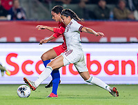 CARSON, CA - FEBRUARY 7: Lynn Williams #13 of the United States fights for the ball with Jimena Lopez #5 of Mexico during a game between Mexico and USWNT at Dignity Health Sports Park on February 7, 2020 in Carson, California.