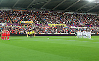 Pictured: York and Swansea players observe a minute's silence before kick off Tuesday 25 August 2015<br /> Re: Capital One Cup, Round Two, Swansea City v York City at the Liberty Stadium, Swansea, UK.