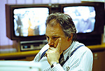 Peter Sissons, British Television News presenters, BBC News at 6.00 studio. Reading notes before going on air. 1990s UK