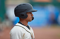 Nick Gonzales (2) of the Greensboro Grasshoppers waits for his turn to hit during the game against the Rome Braves at First National Bank Field on May 16, 2021 in Greensboro, North Carolina. (Brian Westerholt/Four Seam Images)