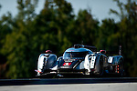 Timo Bernhard (DEU) / Marcel Fa?ssler (CHE) / Romain Dumas (FRA), #1 Audi Sport Team Joest Audi R18 chassis, LMP1 category during practice for the 14th annual Petit Le Mans held at Road Atlanta in Braselton GA, USA.