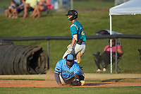Dry Pond Blue Sox first baseman Derek Farley (40) (SouthLake Christian HS) stretches for a low throw as Justin Fox (2) (Erskine College) of the Mooresville Spinners crosses the base at Moor Park on July 2, 2020 in Mooresville, NC.  The Spinners defeated the Blue Sox 9-4. (Brian Westerholt/Four Seam Images)