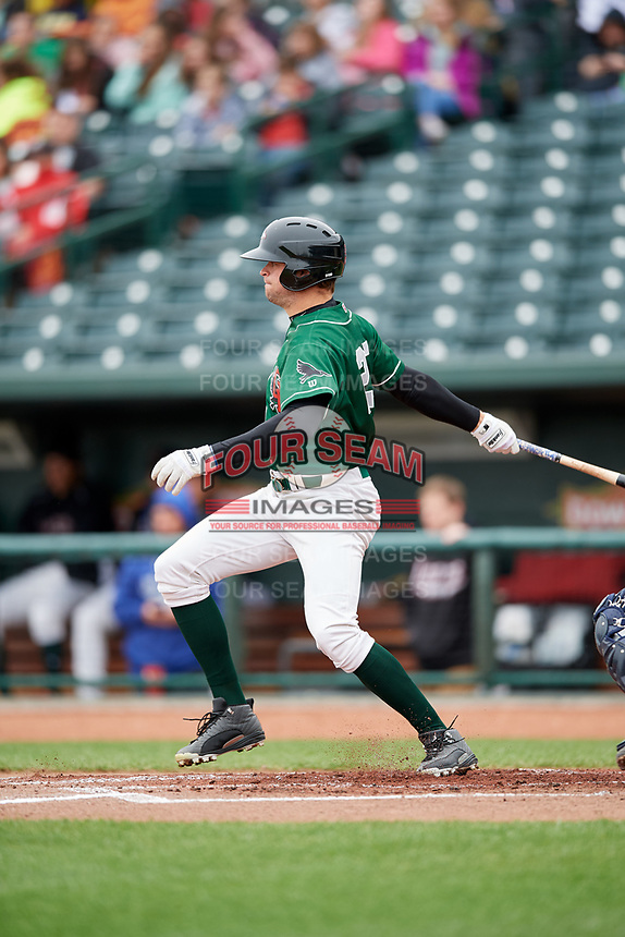 Great Lakes Loons center fielder Cody Thomas (25) follows through on a swing during a game against the Burlington Bees on May 4, 2017 at Dow Diamond in Midland, Michigan.  Great Lakes defeated Burlington 2-1.  (Mike Janes/Four Seam Images)