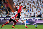 Lucas Vazquez (R) of Real Madrid is tackled by Inigo Cordoba Kerejeta (C) and Mikel Balenziaga Oruesagasti of Athletic Club de Bilbao during the La Liga 2017-18 match between Real Madrid and Athletic Club Bilbao at Estadio Santiago Bernabeu on April 18 2018 in Madrid, Spain. Photo by Diego Souto / Power Sport Images