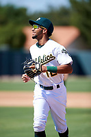 Oakland Athletics shortstop Yerdel Vargas (12) jogs off the field between innings during an Instructional League game against the Cincinnati Reds on September 29, 2017 at Lew Wolff Training Complex in Mesa, Arizona. (Zachary Lucy/Four Seam Images)
