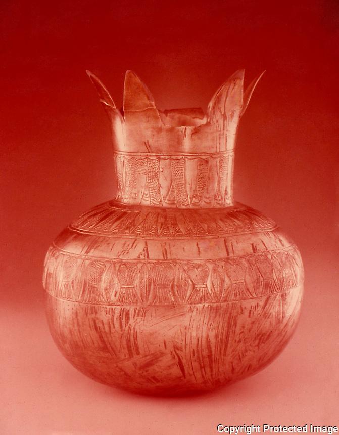 Egypt:  Pomegranate Vase--gold and silver alloy.  Treasures of Tutankhamun, Cairo Museum.  MMA 1976.
