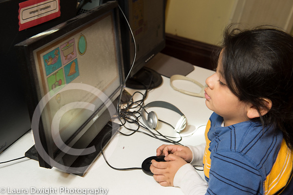 Education Preschool 3-4 year olds boy playing educational game on computer