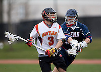 Jake Bernhardt (3) of Maryland tries to find a pass away from  Al Kohart (21) of Penn at Ludwig Field in College Park, Maryland.