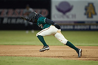 Liover Peguero (10) of the Greensboro Grasshoppers takes  off for second base against the Hickory Crawdads at First National Bank Field on May 6, 2021 in Greensboro, North Carolina. (Brian Westerholt/Four Seam Images)