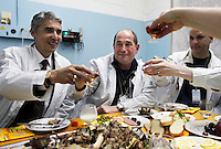Igor Bolshinsky (centre) and Jay Thomas (centre right) dine inside the nuclear reactor with Kazakh nuclear physicists, including Adil Tuleushev, director of the Institute of Nuclear Physics, to celebrate the removal of highly enriched uranium (HEU) from the institute in Almaty. The removal of Kazakhstan's HEU is part of the U.S. Global Threat Reduction Initiative (GTRI), where Bolshinsky works, which tries to secure nuclear material around the world to prevent their misuse.
