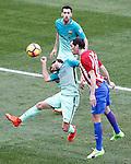Atletico de Madrid's Diego Godin (r) and FC Barcelona's Sergi Roberto (l) and Sergio Busquets during La Liga match. February 26,2017. (ALTERPHOTOS/Acero)
