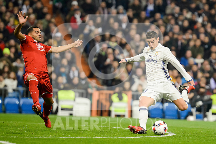 Real Madrid's James Rodriguez and Sevilla FC's Mercado during Copa del Rey match between Real Madrid and Sevilla FC at Santiago Bernabeu Stadium in Madrid, Spain. January 04, 2017. (ALTERPHOTOS/BorjaB.Hojas)