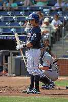 Durham Bulls catcher Craig Albernaz #4 at bat during a game against the Louisville Bats at Durham Bulls Athletic Park on May 2, 2012 in Durham, North Carolina. Durham defeated Louisville by the score of 7-5. (Robert Gurganus/Four Seam Images)