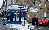 Signage for the entrance to the COVID-19 Vaccinations at Aspire Pharmacy, Hadlow Road, Sidcup, Kent, England on the 8 February 2021. Photo by Alan Stanford.