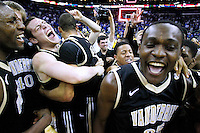 Vanderbilt Commodores forward James Siakam (35) celebrates with his teammates after their his team defeated the Kentucky Wildcats 71-64 during the final of the SEC men's NCAA basketball tournament in New Orleans, Louisiana March 11, 2012.  Vanderbilt has not won the SEC Championship since 1951.