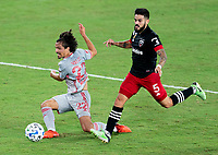 WASHINGTON, DC - SEPTEMBER 12: Florian Valot #22 of the New York Red Bulls takes a shot during a game between New York Red Bulls and D.C. United at Audi Field on September 12, 2020 in Washington, DC.