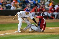 Jose Marmolejos (3) of the Potomac Nationals slides into third base ahead of the tag by Gerson Montilla (17) of the Winston-Salem Dash at BB&T Ballpark on May 13, 2016 in Winston-Salem, North Carolina.  The Dash defeated the Nationals 5-4 in 11 innings.  (Brian Westerholt/Four Seam Images)