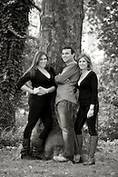 Black & white portrait of brother and sisters in Carl Schurz Park on Manhattan's Upper East Side.