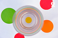 Glass on tablecloth with multi-colored spots (Licence this image exclusively with Getty: http://www.gettyimages.com/detail/104143544 )
