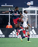 FOXBOROUGH, MA - JULY 25: Christian Mafla #32 of New England Revolution and Sunusi Ibrahim #22 of CF Montreal compete for a high ball during a game between CF Montreal and New England Revolution at Gillette Stadium on July 25, 2021 in Foxborough, Massachusetts.