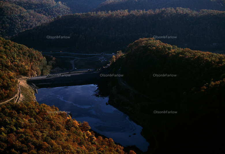 A slurry of water filled with toxic sludge--a by-product of washing coal in mountaintop removal mining-- contains high levels of mercury, manganese and other heavy metals. A dam holds back the pond which is located over an elemantary school.