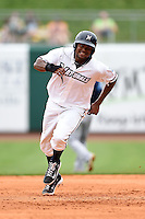 NW Arkansas Naturals outfielder Jorge Bonifacio (24) runs the bases during a game against the Corpus Christi Hooks on May 26, 2014 at Arvest Ballpark in Springdale, Arkansas.  NW Arkansas defeated Corpus Christi 5-3.  (Mike Janes/Four Seam Images)