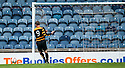 Alloa's Andy Kirk knocks the ball past the post when it looked easier to hit the empty net.