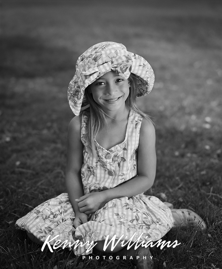 Cute Girl Wearing Sun Hat & Dress, Kapiolani Park, Honolulu, Hawaii, USA.