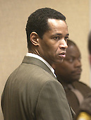 Sniper suspect John Allen Muhammad, stands during a break in his trial in courtroom 10 at the Virginia Beach Circuit Court in Virginia Beach, Virginia on November 5, 2003. <br /> Credit: Dave Ellis - Pool via CNP