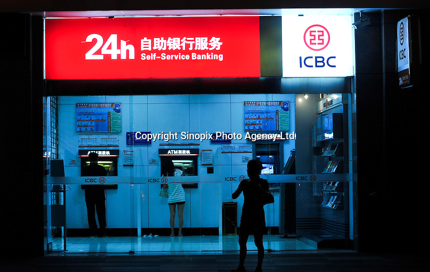 People use ATM machine in ICBC (Industustrial and Commercial Bank of China), Chengdu, China. ICBC is China's largest bank which has offices and subsidiaries in many countries around the world..