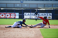 GCL Rays second baseman Joseph Astacio (7) attempts to tag Luis Alejandro Basabe (18) sliding into second during the first game of a doubleheader against the GCL Red Sox on August 4, 2015 at Charlotte Sports Park in Port Charlotte, Florida.  GCL Red Sox defeated the GCL Rays 10-2.  (Mike Janes/Four Seam Images)