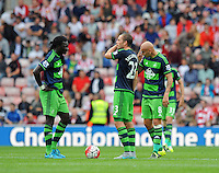 (l-r) Bafetibis Gomis of Swansea City, Gylfi Sigurosson of Swansea City and Jonjo Shelvey of Swansea City look on dejected after conceding a goal during the Barclays Premier League match between Sunderland and Swansea City played at Stadium of Light, Sunderland